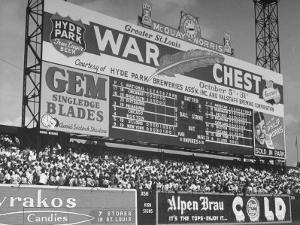 Large Scoreboard Towering over Fans Showing Baseball Scores from Around the League by Wallace Kirkland