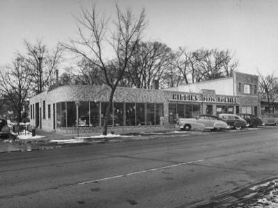 Outside of George Higgins Pontiac Dealership by Wallace Kirkland