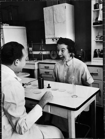 Pregnant Mrs. Jane Dill, After Being Told the Chemical Wafer on Tongue Indicates Baby is a Girl by Wallace Kirkland