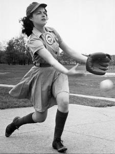 Pro Baseball Pitcher For Rockford Peaches, Caroline Morris, Demonstrating Her Underhanded Delivery by Wallace Kirkland