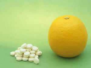 Vitamin C Tablets and an Orange, a Natural Source of This and Other Nutrients by Wally Eberhart