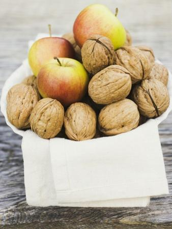 Walnuts and Apples on Cloth in White Bowl