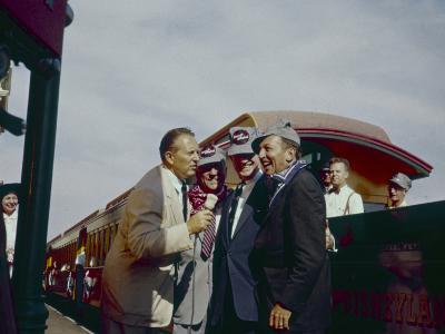 Walt Disney Being Interviewed by Train at Disneyland. Anaheim, California 1955-Allan Grant-Photographic Print
