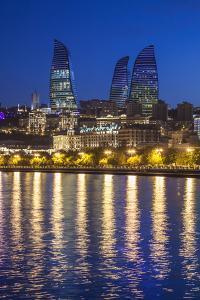Azerbaijan, Baku. Bulvar Promenade, city skyline with Flame Towers. by Walter Bibikow
