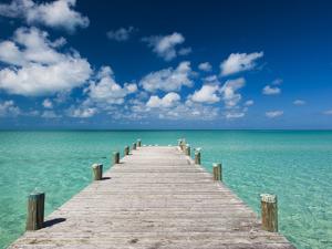 Bahamas, Eleuthera Island, Tarpum Bay, Town Pier by Walter Bibikow