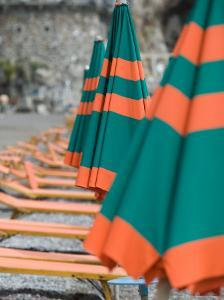 Beach Umbrellas, Spiaggia Grande, Positano, Amalfi Coast, Campania, Italy by Walter Bibikow