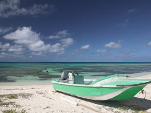 Boat and Turquoise Water on Pillory Beach, Turks and Caicos, Caribbean by Walter Bibikow