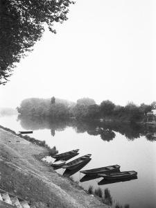 Boats along the River Vienne, Tourain, France by Walter Bibikow