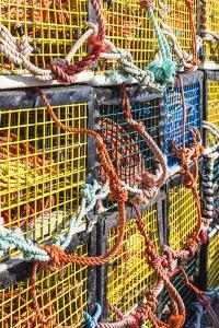 Canada, Nova Scotia, Peggy's Cove. Fishing village on the Atlantic Coast, lobster traps. by Walter Bibikow