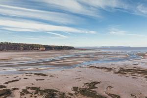 Canada, Nova Scotia, Walton. Low tide on the Minas Basin. by Walter Bibikow
