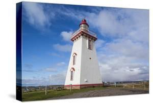 Canada, Prince Edward Island, Souris East Lighthouse. by Walter Bibikow