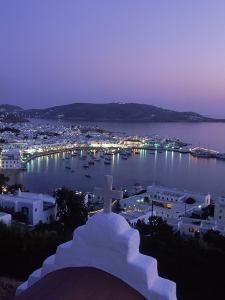 Chapel & Mykonos Town at Night, Greece by Walter Bibikow