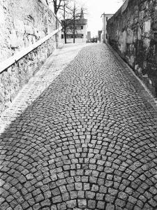 Cobbled Street, Lindenhof, Switzerland by Walter Bibikow
