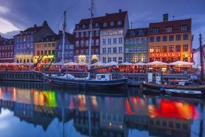 Denmark, Zealand, Copenhagen, Nyhavn Harbor, Evening by Walter Bibikow