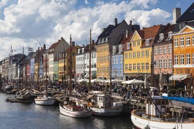 Denmark, Zealand, Copenhagen, Nyhavn Harbor by Walter Bibikow
