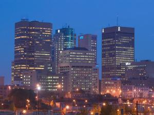 Downtown Highrise Buildings from The Forks at Dawn, Winnipeg, Manitoba by Walter Bibikow