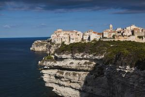Elevated View of City and Cliffs, Bonifacio, Corsica, France by Walter Bibikow