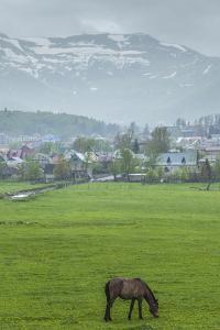 Georgia, Bakuriani. Ski resort town, view of town and mountains. by Walter Bibikow