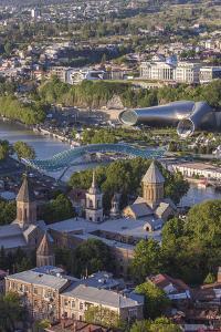 Georgia, Tbilisi. View of city skyline from Narikala Fortress. by Walter Bibikow
