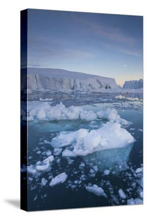 Greenland, Disko Bay, Ilulissat, Floating Ice at Sunset with Moonrise