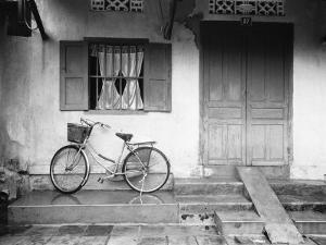 House and Bicycle, Hanoi, Vietnam by Walter Bibikow