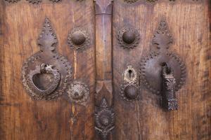 Iran, Kashan, Khan-E Boroujerdi, Ornate Door With Knockers. by Walter Bibikow