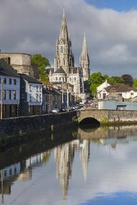 Ireland, County Cork, Cork City, St. Fin Barre's Cathedral seen from the River Lee by Walter Bibikow