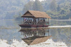 Laos, Sainyabuli. Elephant Conservation Center water shuttle on Nam Tien Reservoir. by Walter Bibikow