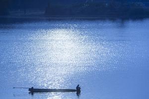 Laos, Sainyabuli. Nam Tien Reservoir, boats. by Walter Bibikow