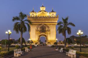 Laos, Vientiane. Patuxai, Victory Monument exterior at dusk. by Walter Bibikow