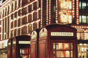 Lit Telephone Booth at Harrods, Knightsbridge, London, England by Walter Bibikow
