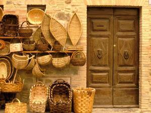 Montalcino, Basket Seller and Wall, Tuscany, Italy by Walter Bibikow