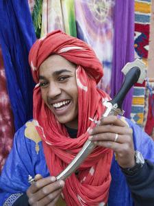 Moroccan Souvenir Seller, Ait Benhaddou, South of the High Atlas, Morocco by Walter Bibikow