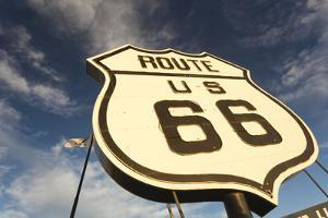 National Route 66 Sign at Sunset, Elk City, Oklahoma, USA by Walter Bibikow