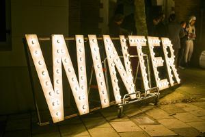 Netherlands, Amsterdam. Signs for the Winter Parade by Walter Bibikow