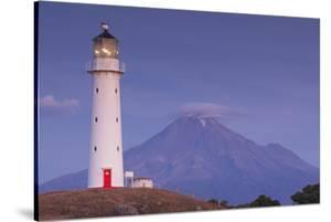New Zealand, North Island, Pungarehu. Cape Egmont Lighthouse and Mt. Taranaki by Walter Bibikow