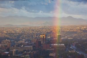 North Carolina, Asheville, Elevated City Skyline with Rainbows, Dawn by Walter Bibikow