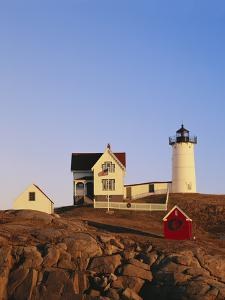 Nubble Lighthouse at Sunset, Cape Neddick, York, Maine, USA by Walter Bibikow