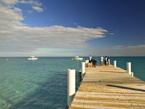 Pier, Grace Bay, Providenciales Island, Turks and Caicos, Caribbean by Walter Bibikow