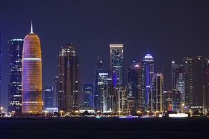Qatar, Doha, Doha Bay, West Bay Skyscrapers, Dusk, with Burj Qatar Tower by Walter Bibikow