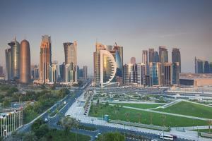 Qatar, Doha, Doha Bay, West Bay Skyscrapers, Elevated View, Dawn by Walter Bibikow