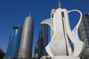 Qatar, Doha, Doha Bay, West Bay Skyscrapers, Morning, with Large Coffeepot Sculpture by Walter Bibikow