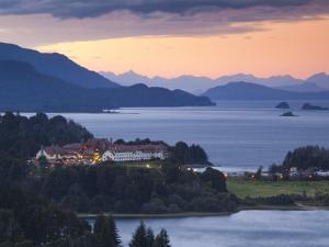 Rio Negro Province, Lake District, Hotel Llao Llao and Lake Nahuel Huapi, Dusk, Argentina by Walter Bibikow