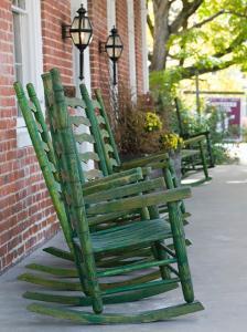 Rocking Chairs on Porch, Ste. Genevieve, Missouri, USA by Walter Bibikow