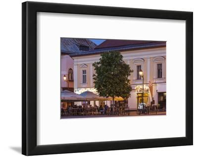 Romania, Baia Mare, Piata Libertatii Square, Outdoor Cafes, Dusk