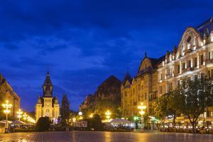 Romania, Banat Region, Timisoara, Piata Victoriei Square and Cathedral by Walter Bibikow