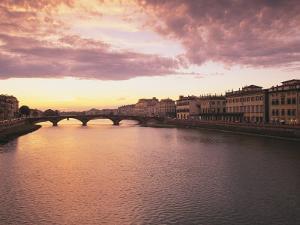 Sunset, Arno River, Tuscany, Italy by Walter Bibikow