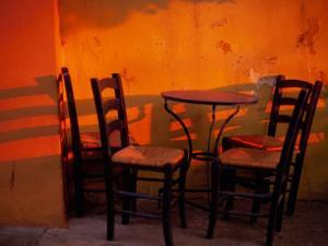 Sunset Light on Cafe Tables, Athens, Greece by Walter Bibikow