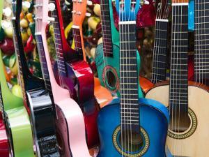 Toy Guitars, Olvera Street Market, El Pueblo de Los Angeles, Los Angeles, California, USA by Walter Bibikow