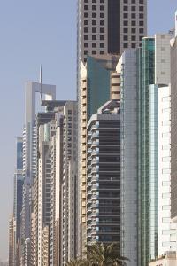 UAE, Downtown Dubai. High-rise buildings along Sheikh Zayed Road by Walter Bibikow